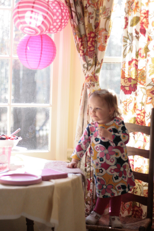 The birthday girl examining the treats